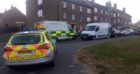 Police and firefighters at St Mungo Terrace last night