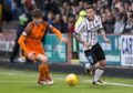 Dunfermline's Fraser Aird (right) in action with Dundee United's Anthony Ralston in the playoffs last month