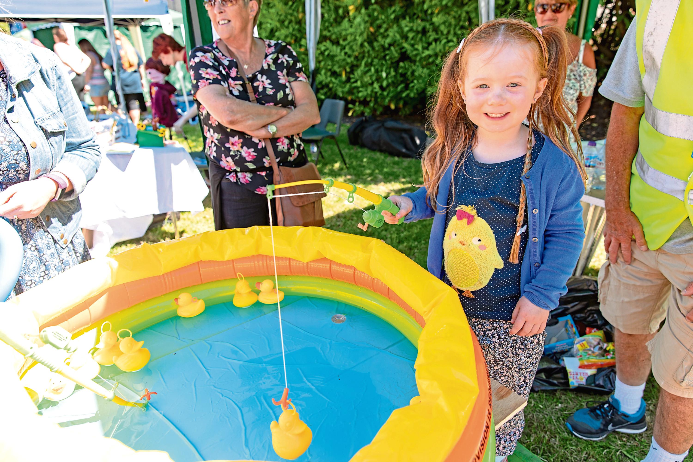 Isla Moir, 5, from Coldside enjoys hooking a duck.