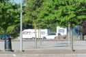 Travellers have pitched up next to the Dundee Ice Arena