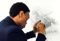 Carl Lavia works on his sketch of Perth