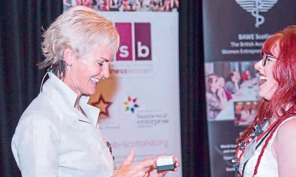 Genna presents Judy Murray with silver earrings