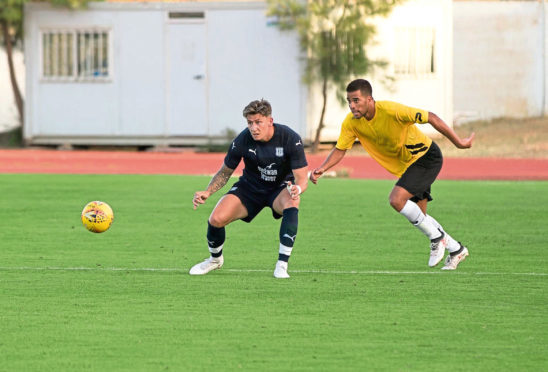 Josh Meekings keeps a close eye on the ball as this Farense player looks to  set up another attack on the Dundee goal.