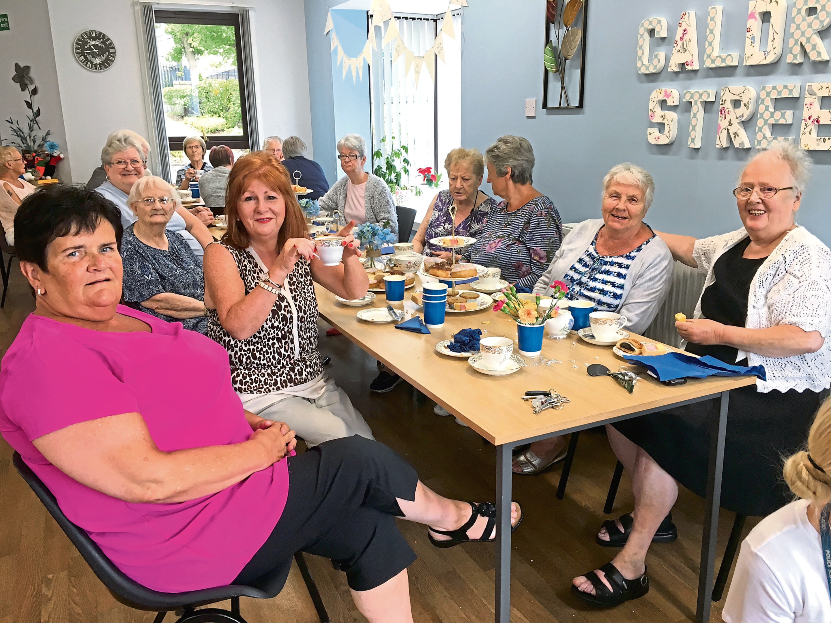 Picture shows residents enjoying their tea.