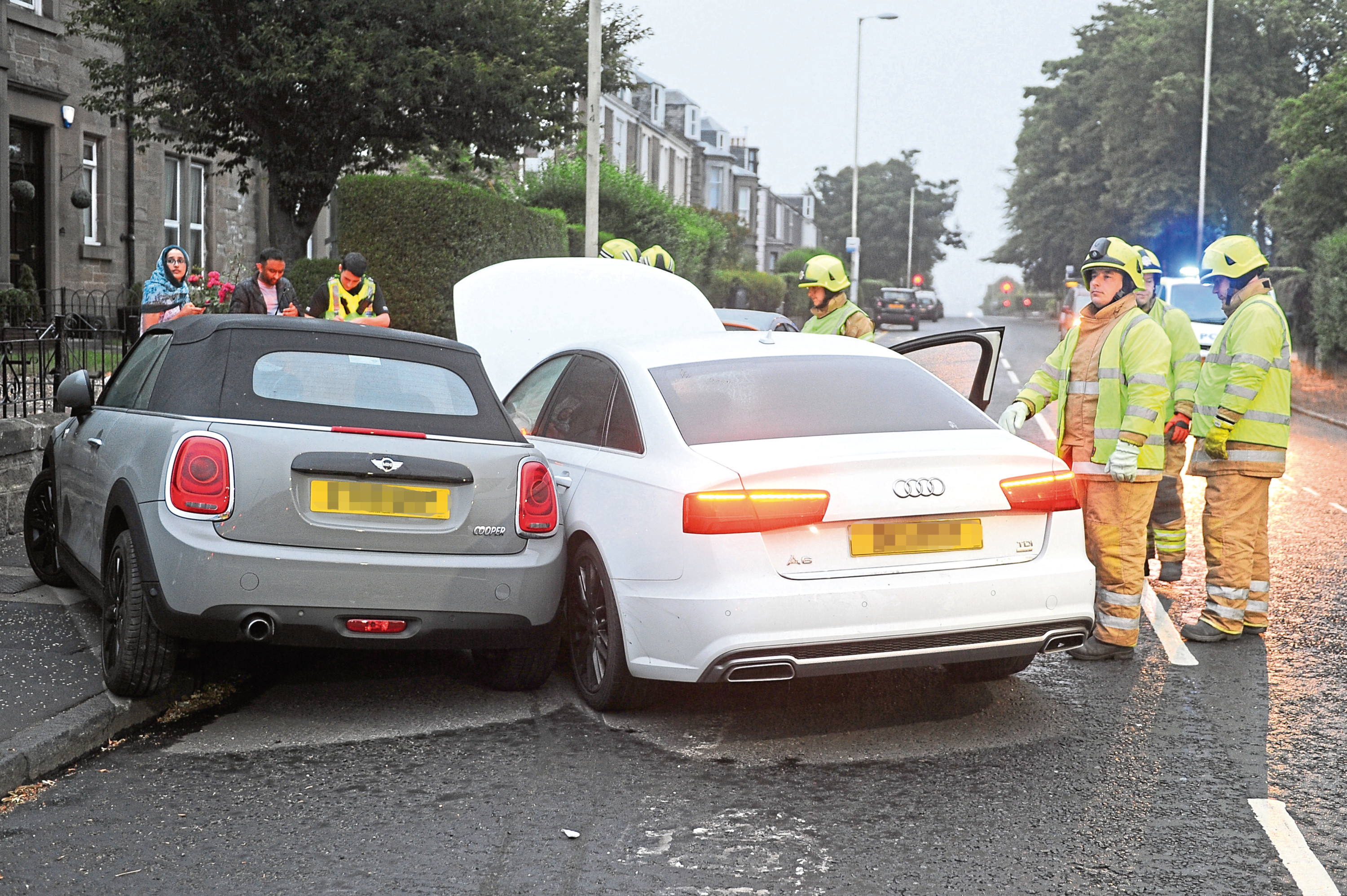 An Audi A6 collided with several vehicles parked at the side of the road Thursday morning.