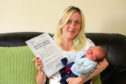 Antonia Dougan shows off her two new arrivals – the certificate for passing her driving test and newborn Bowie.