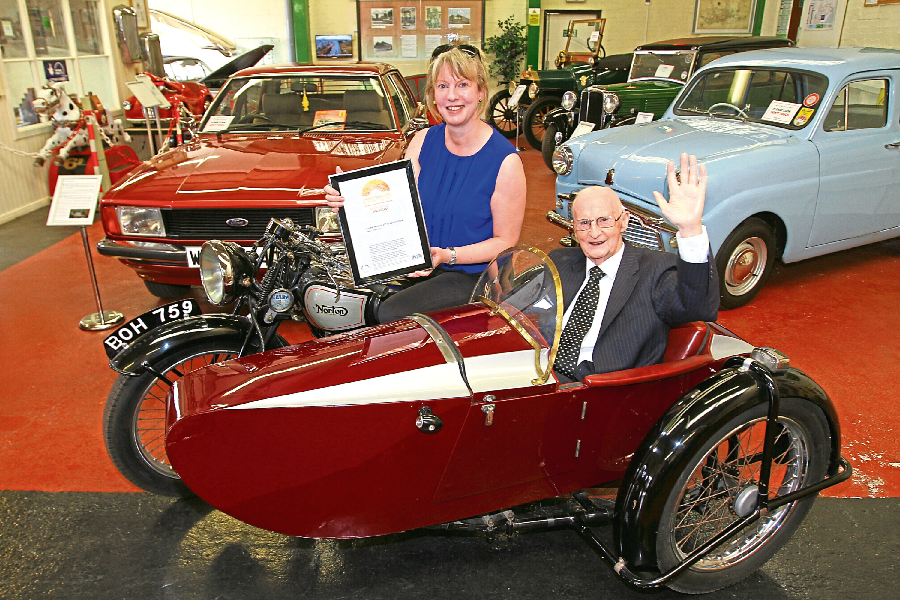 Picture shows Ms Robison and Mr Letford with a classic Norton sidecar outfit from the museum's collection.