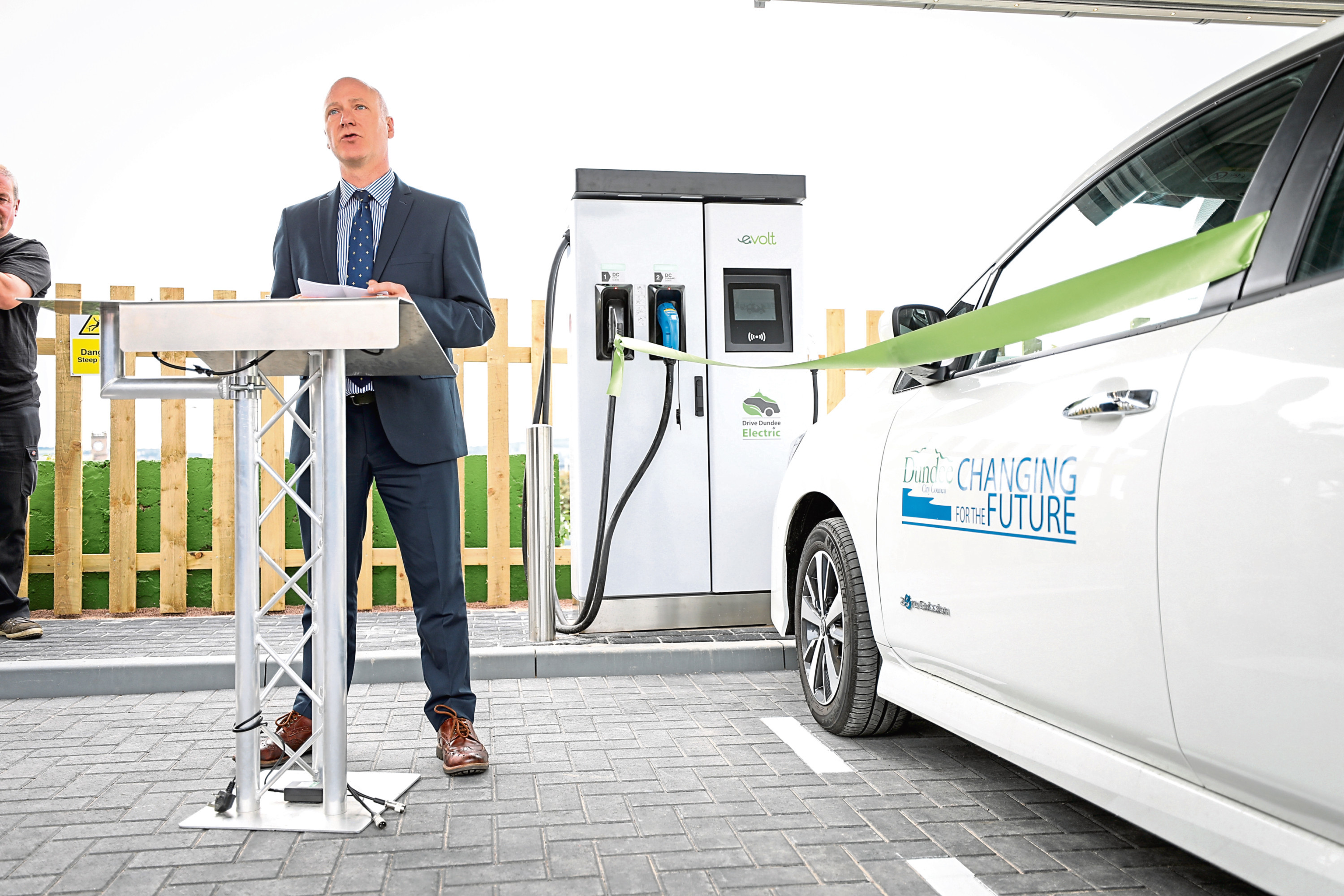 Picture shows Mr FitzPatrick in front of one of the charging points opening the centre.