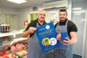 Butchers Ian and Lee Dunbar are fundraising for a defibrillator.