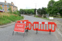 Residents say the closure from the roundabout at Coupar Angus Road to the junction with Loon's Road is causing major inconvenience.