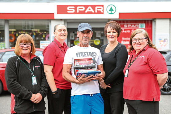 Kirsty (second left) with Ann Murray, customer Gary Johnstone, Tracey Munro and Pauline Wilson
