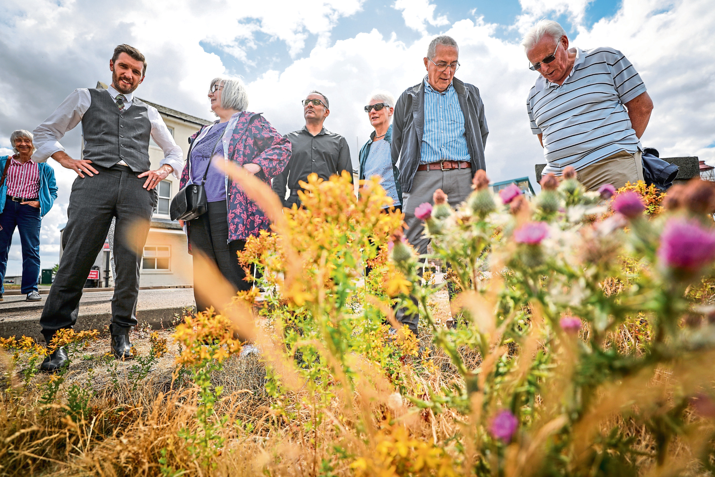 Members of the City Centre and Harbour Community Council during a walkabout to highlight some of City Quay's weeds and rundown areas.