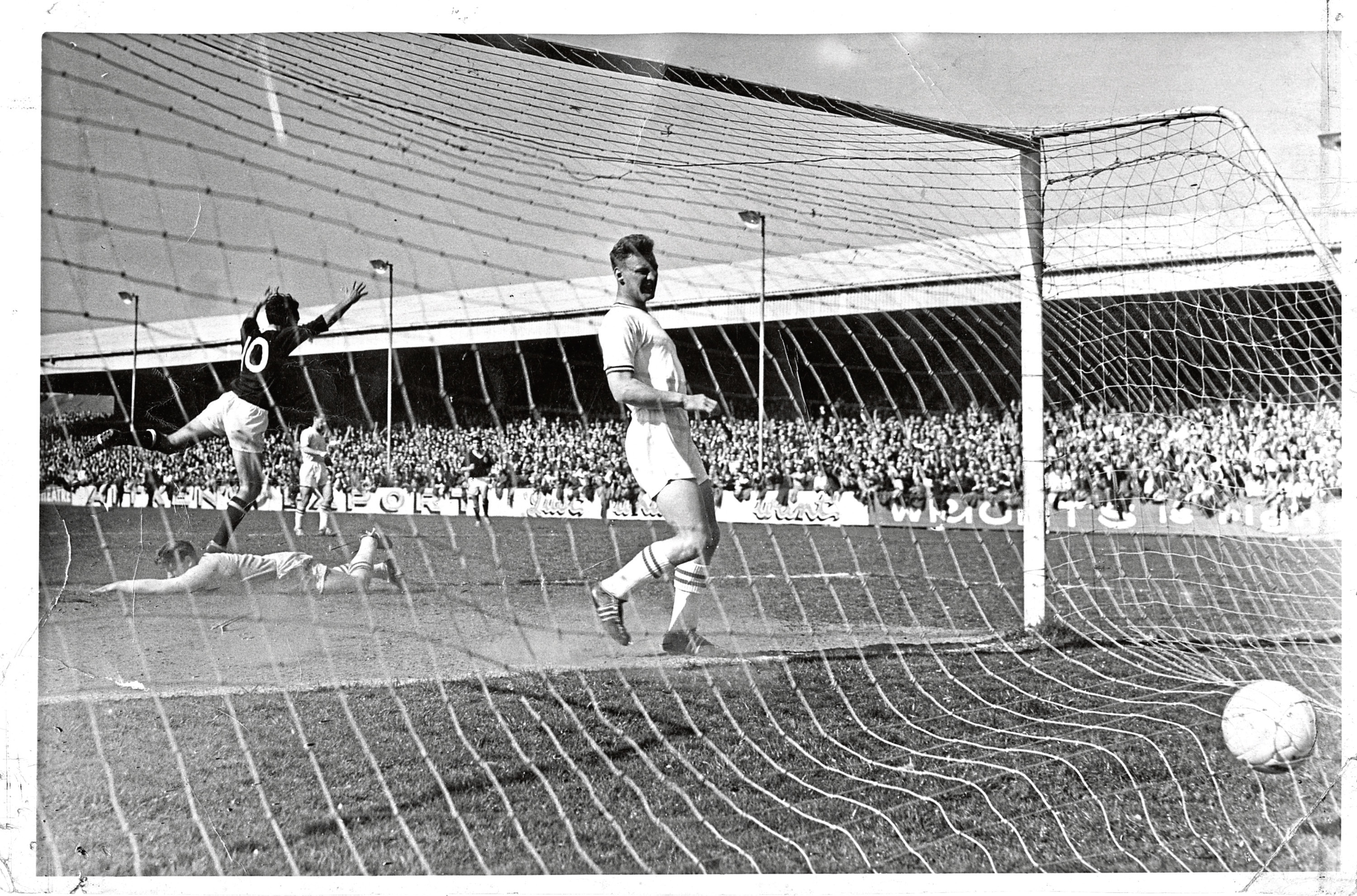 An iconic moment in 1962 as Alan Gilzean (No 10) scores to put Dundee 2-0 ahead against St Johnstone at Muirton Park as the Dark Blues sealed the First Division League title.