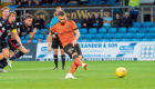 Nicky Clark saw his penalty saved by Scott Fox as Dundee United lost out to Ross County in the Betfred Cup in Dingwall on Tuesday night.
