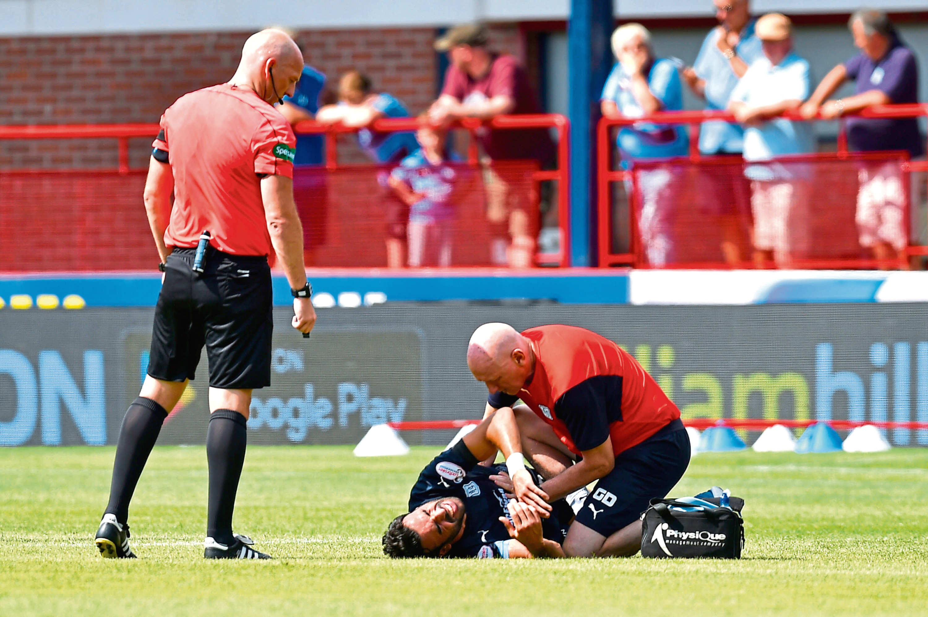 Dundee's Sofien Moussa is treated by physios