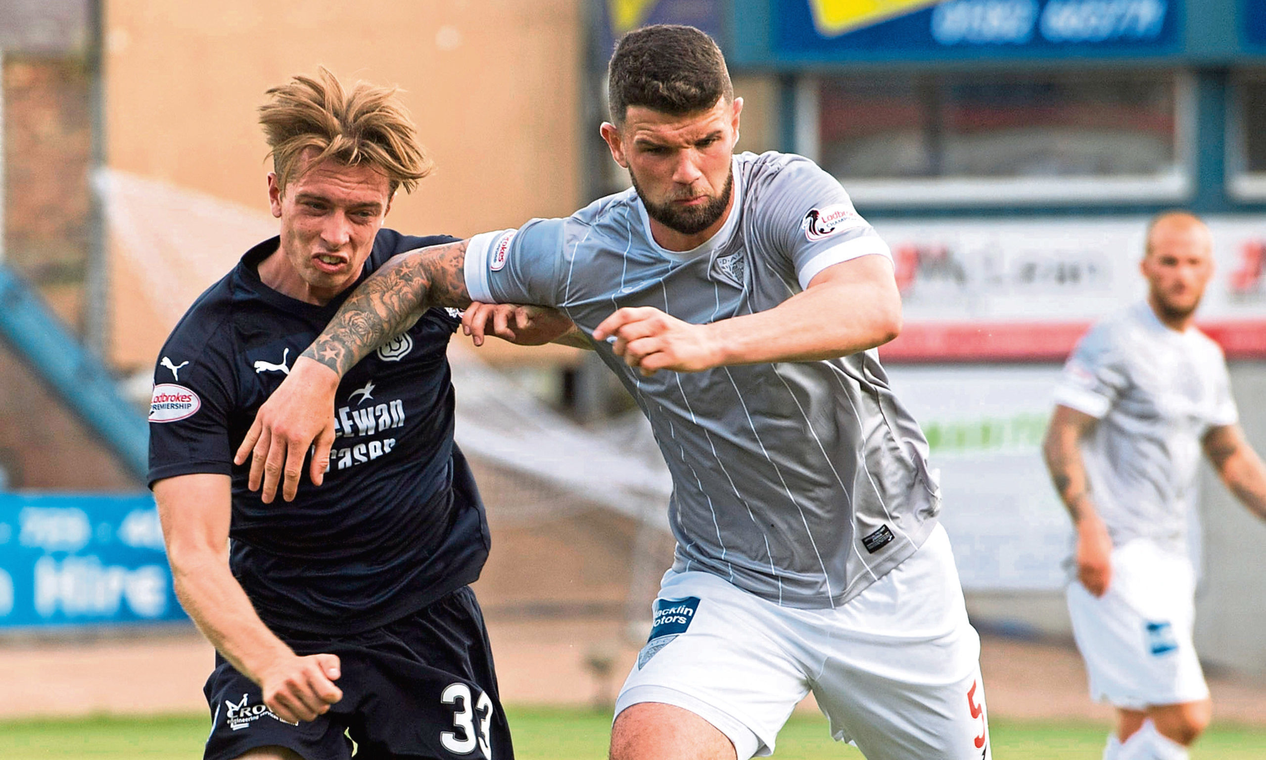 Dunfermline's Mark Durnan (right) and Craig Wighton in action.