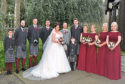 Lisa and Lewis with the wedding party on their big day.