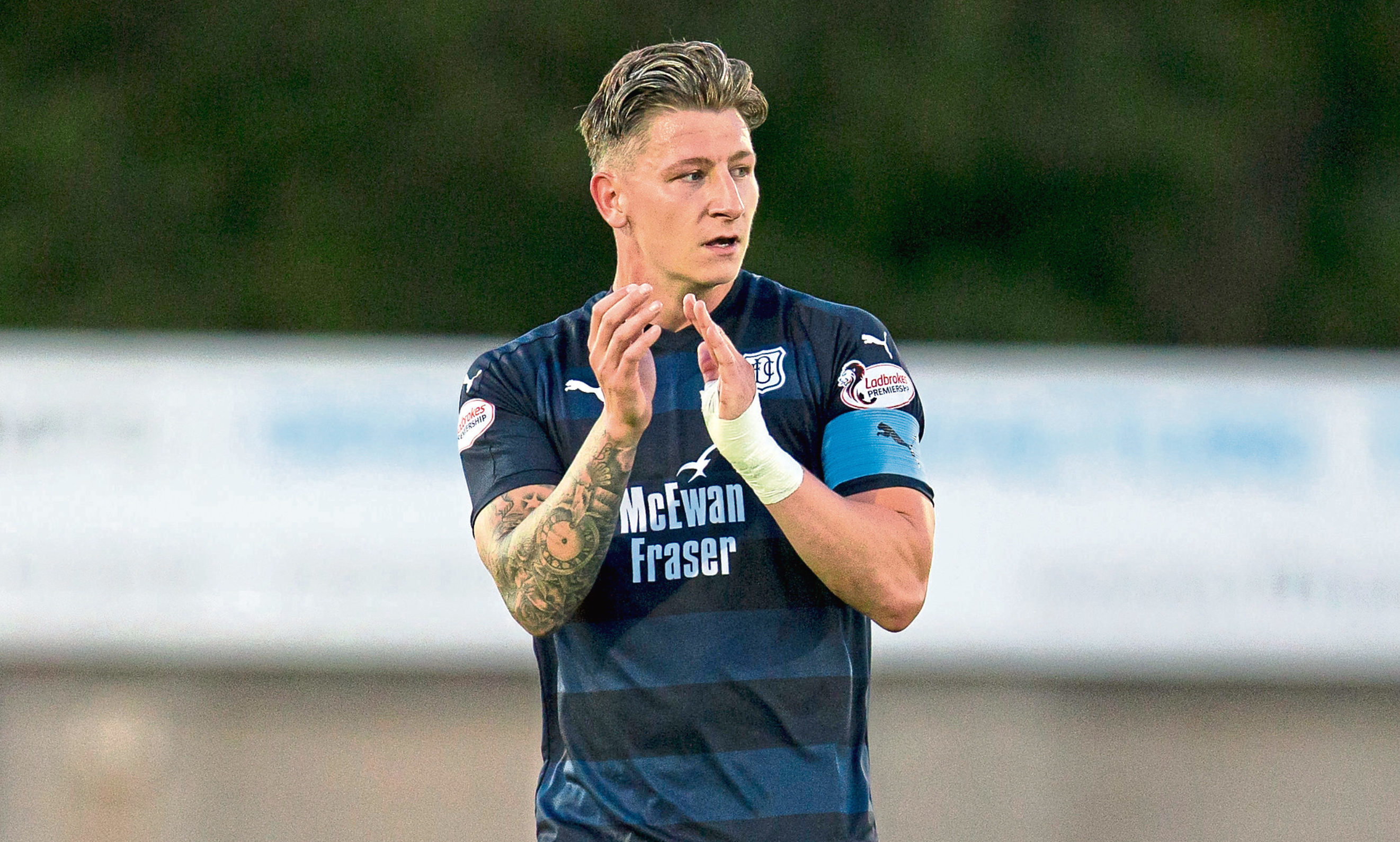 Dundee's Josh Meekings applauds the fans at the end against Peterhead