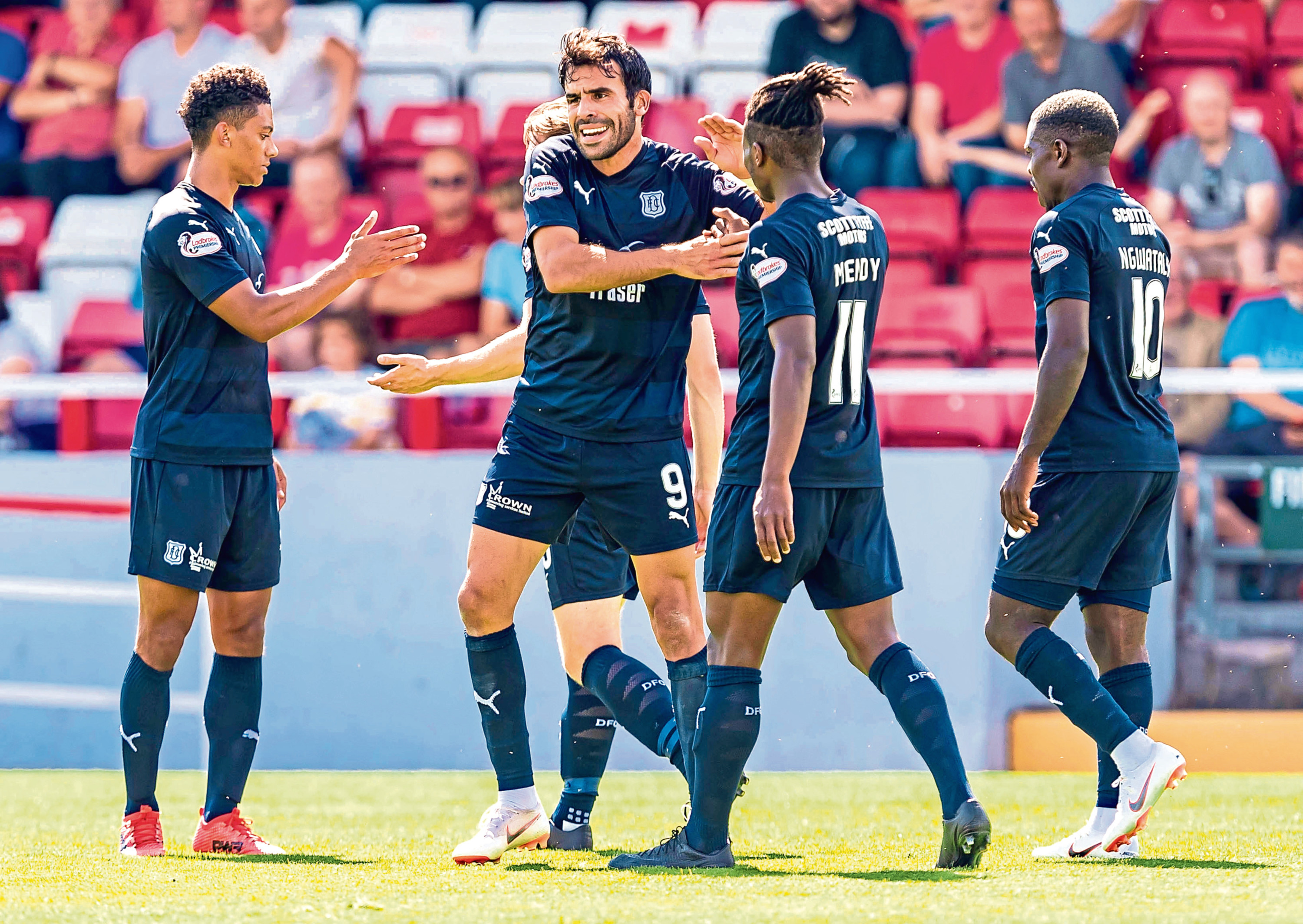 Dundee's Sofien Moussa celebrates scoring against Stirling Albion with his team mates