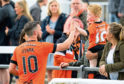 Nicky Clark celebrates with a young Dundee United fan after grabbing his second and third goals for the club in the 4-0 win over Elgin City on Saturday.