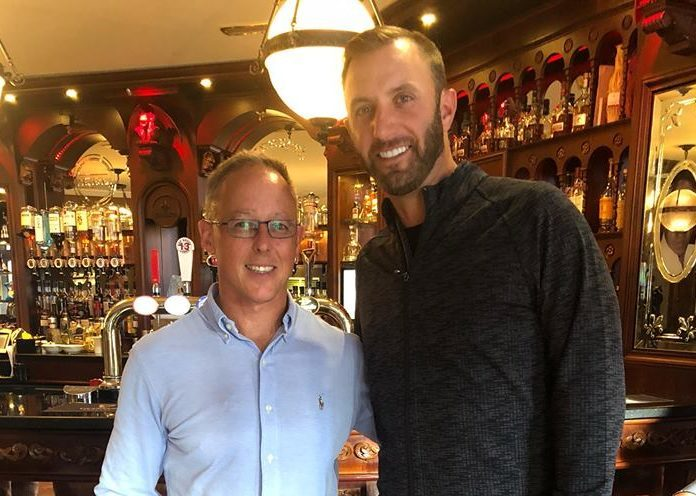 Dustin Johnson with The Fort manager John Black