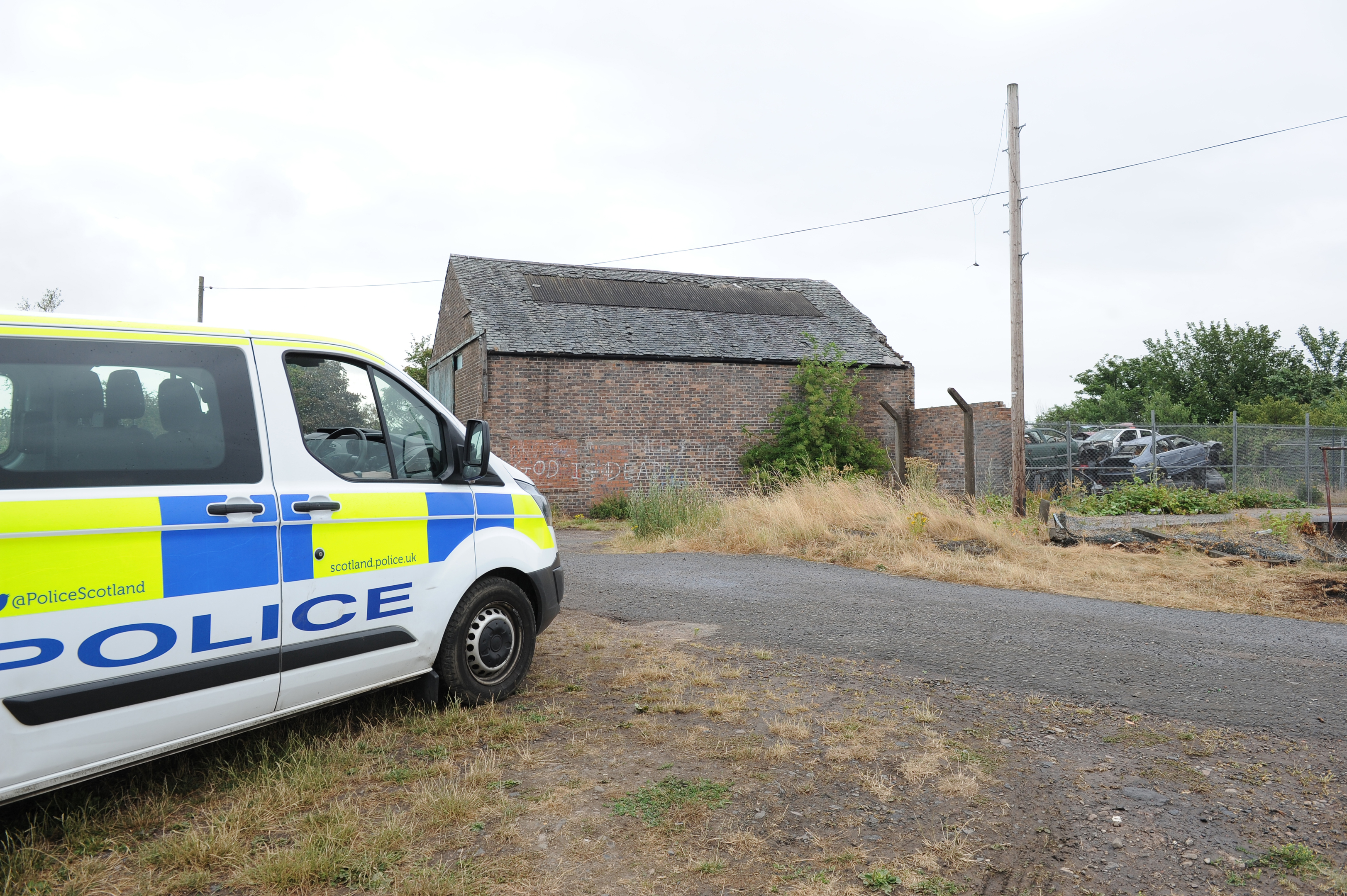 Police at the fire hit scrapyard