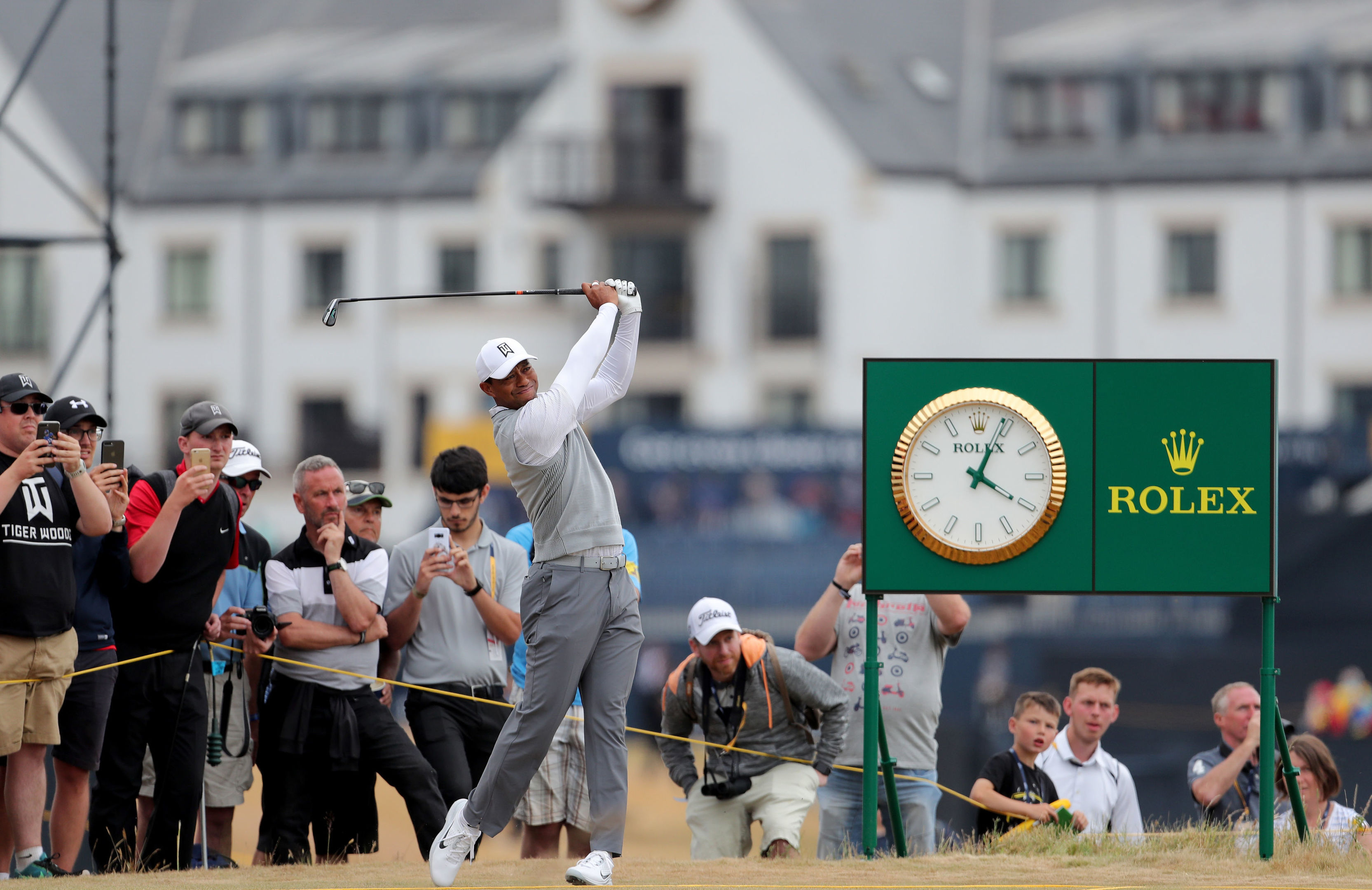 Tiger Woods tees off at The Open in Carnoustie.