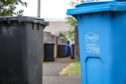 Courier/Tele News, Ciaran Shanks story. Wheelie bins in lanes around Strathmore Street area of Barnhill Dundee for files. Pic shows; Dundee City Council wheelie bins in Barnhill. Thursday, 12th July, 2018.