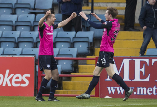 Craig Wighton goes to celebrate after Cammy Kerr scored his first goal for boyhood team Dundee