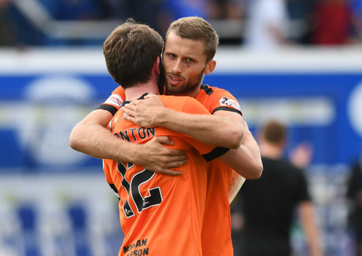 Safranko celebrates with Sam Stanton at Palmerston.