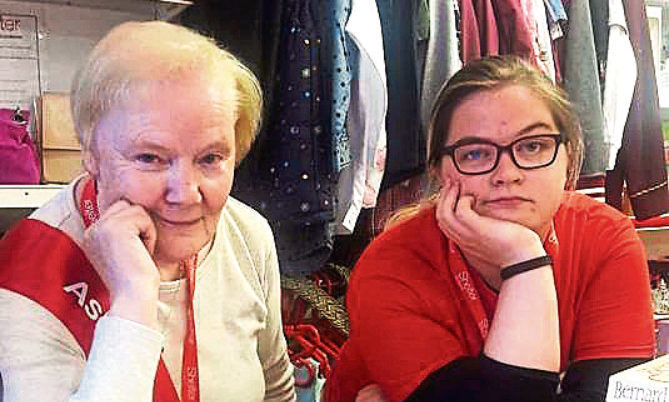 Shop worker Dorothy Westwater, 72, with Eilidh Phillips, 23, cashier