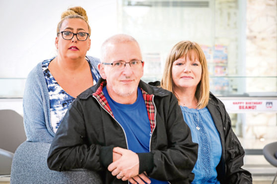 Families of those who have died following treatment or discharge at the Carseview Centre in Dundee have restated concerns about the independence of an inquiry into mental health services in Tayside. Pictured are Mandy McLaren, Malcolm and Karen Nichol (parents of Scott)