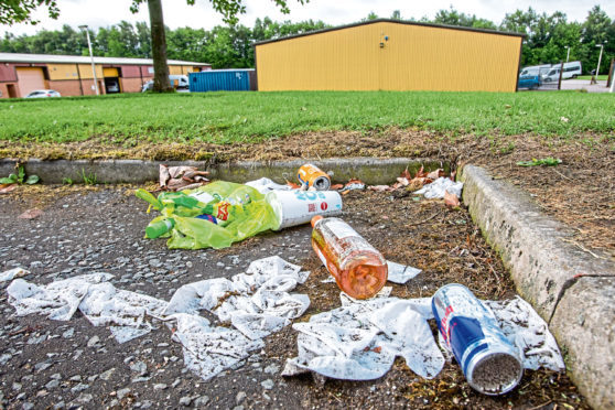 Rubbish left at a site which had been occupied by a group of Travellers.