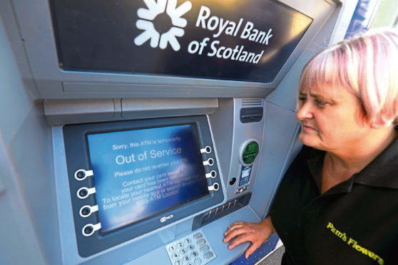 Florist Liz Mcgee says the broken cash machine is affecting her business.