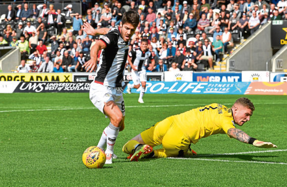 St Mirren's Ryan Flynn takes the ball round Dundee keeper Jack Hamilton after his blunder