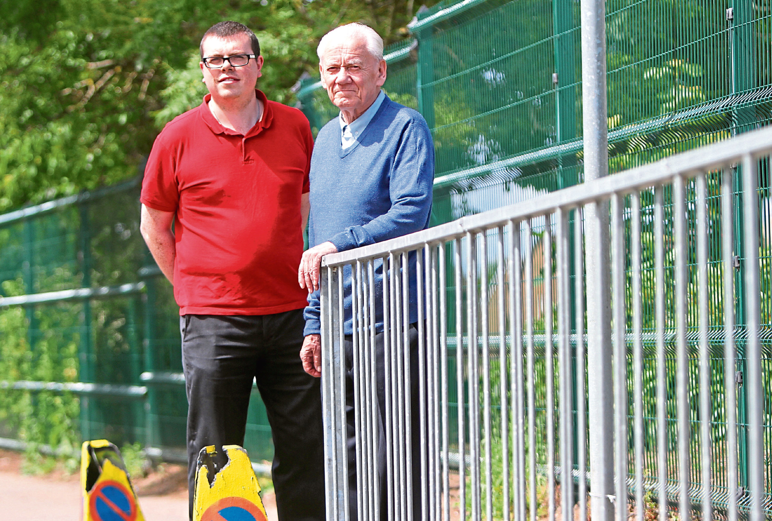 Community council member Simon Redmond and chairman Ron Neave outside the school.