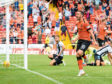 Nicky Clark's goal gave United the perfect start against Dunfermline.