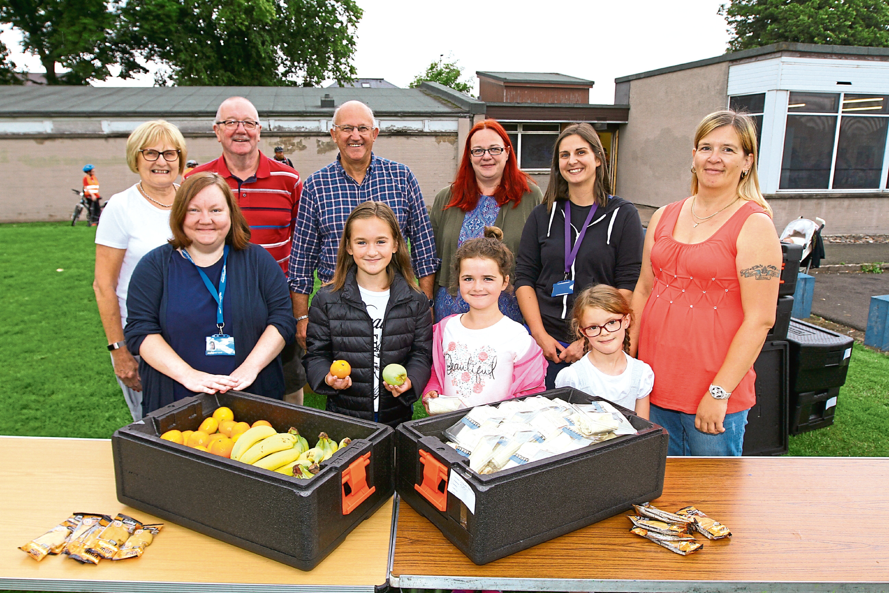 Dundee Bairns was handing out food, to Rosie Hutton (10), Annabel Hutton (7) and Piper Moir (6) at Lochee Fun Day