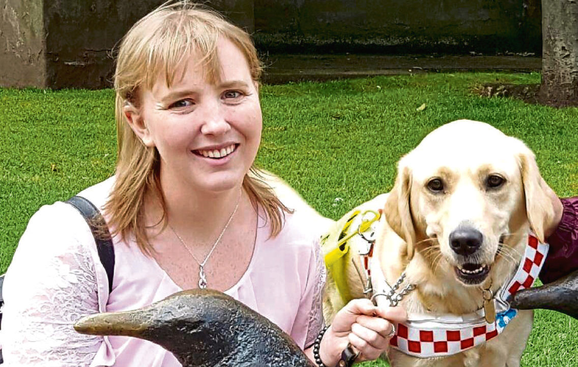 Lisa Halley and her dual guide dog Jumble