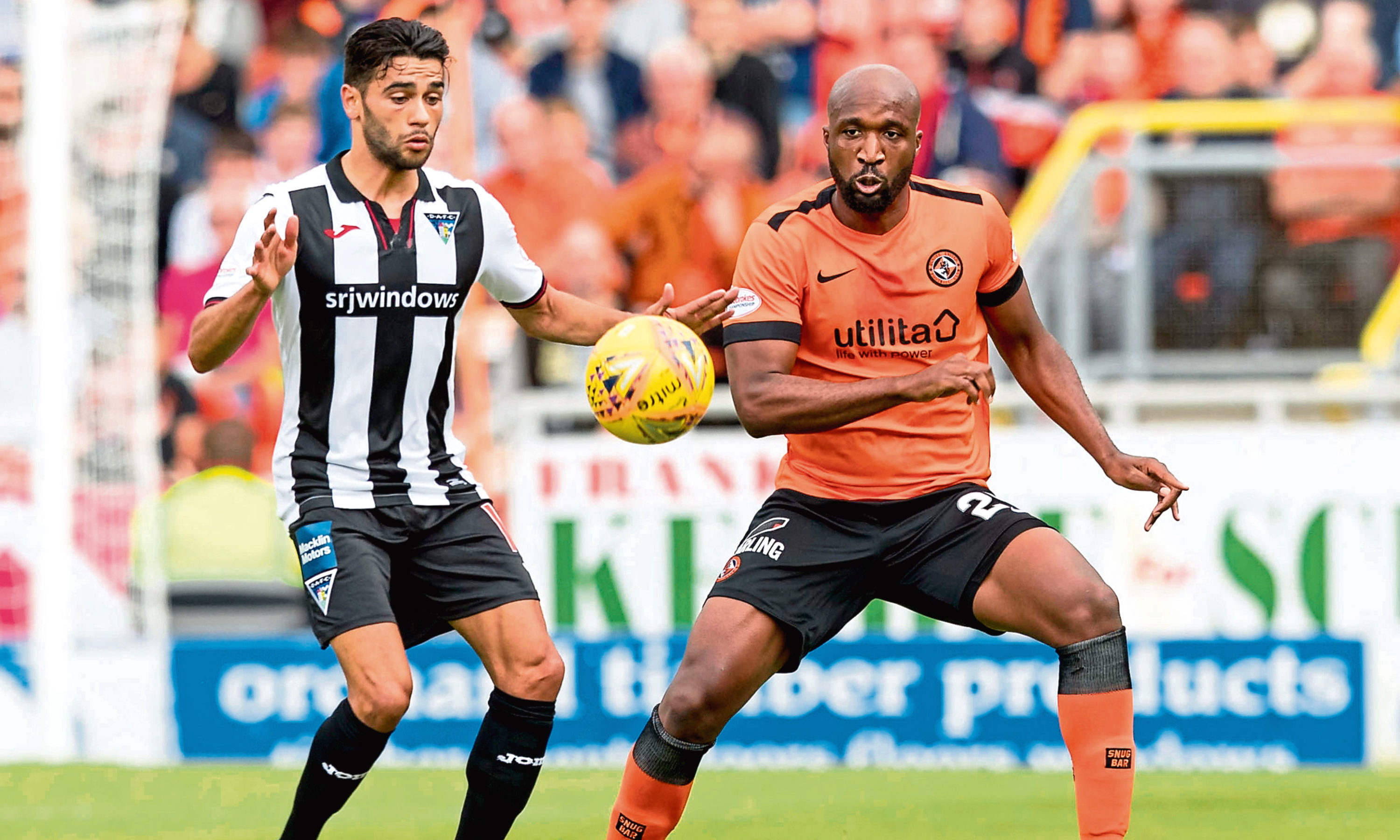 Dunfermline's Faissal El Bakhtaoui (left) in action against Dundee United's William Edjenguele