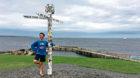 Daniel Angelosanto, 24, at the finish line in John O'Groats