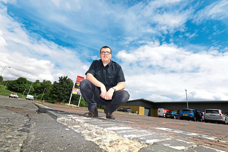 Simon Redmond at the broken pavement on Pitkerro Road