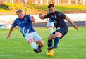 Dundee's Adil Nabi and Cowdenbeath's Ronan McMurchie in action.