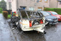 The remains of the burnt-out caravan in Buttar's Place in Charleston, Dundee