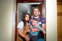 Dillan Flynn, pictured with his partner Katie and their son, Kadyn, has warned householders after suffering repeated break-ins at home.