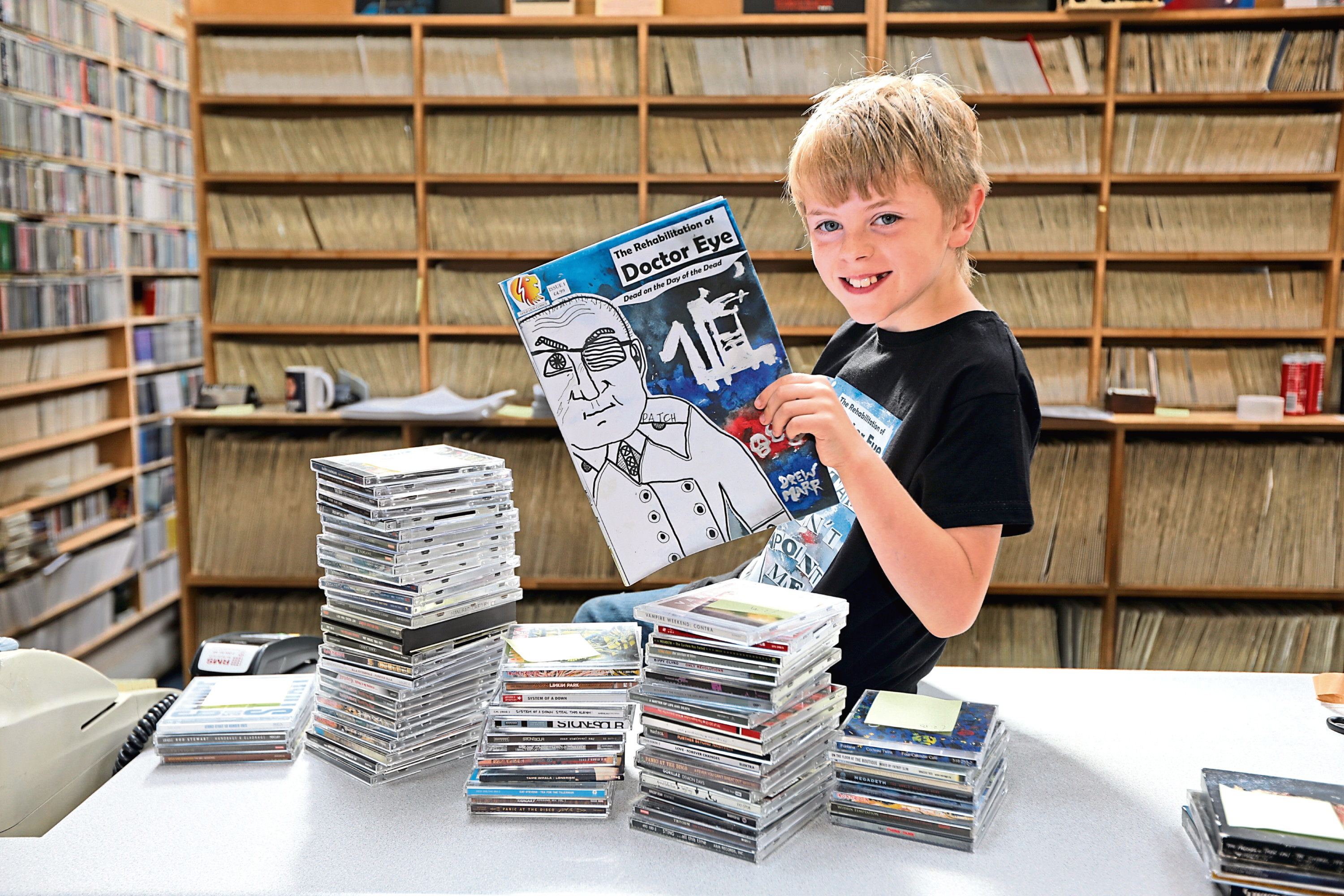 Drew Marr, 10, with a copy of the second instalment of the Doctor Eye comic he created, in Groucho's.