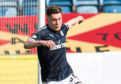 Young striker Cedwyn Scott in action for Dundee last season