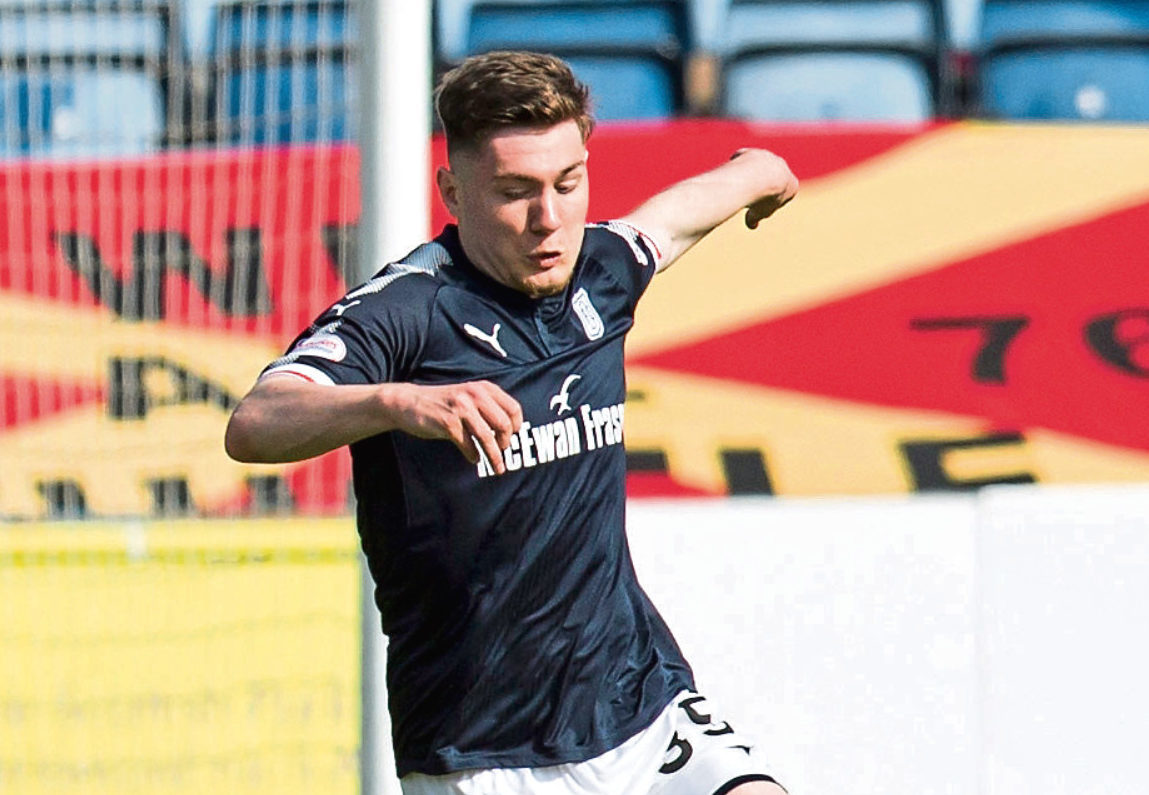 Young striker Cedwyn Scott in action for Dundee last season