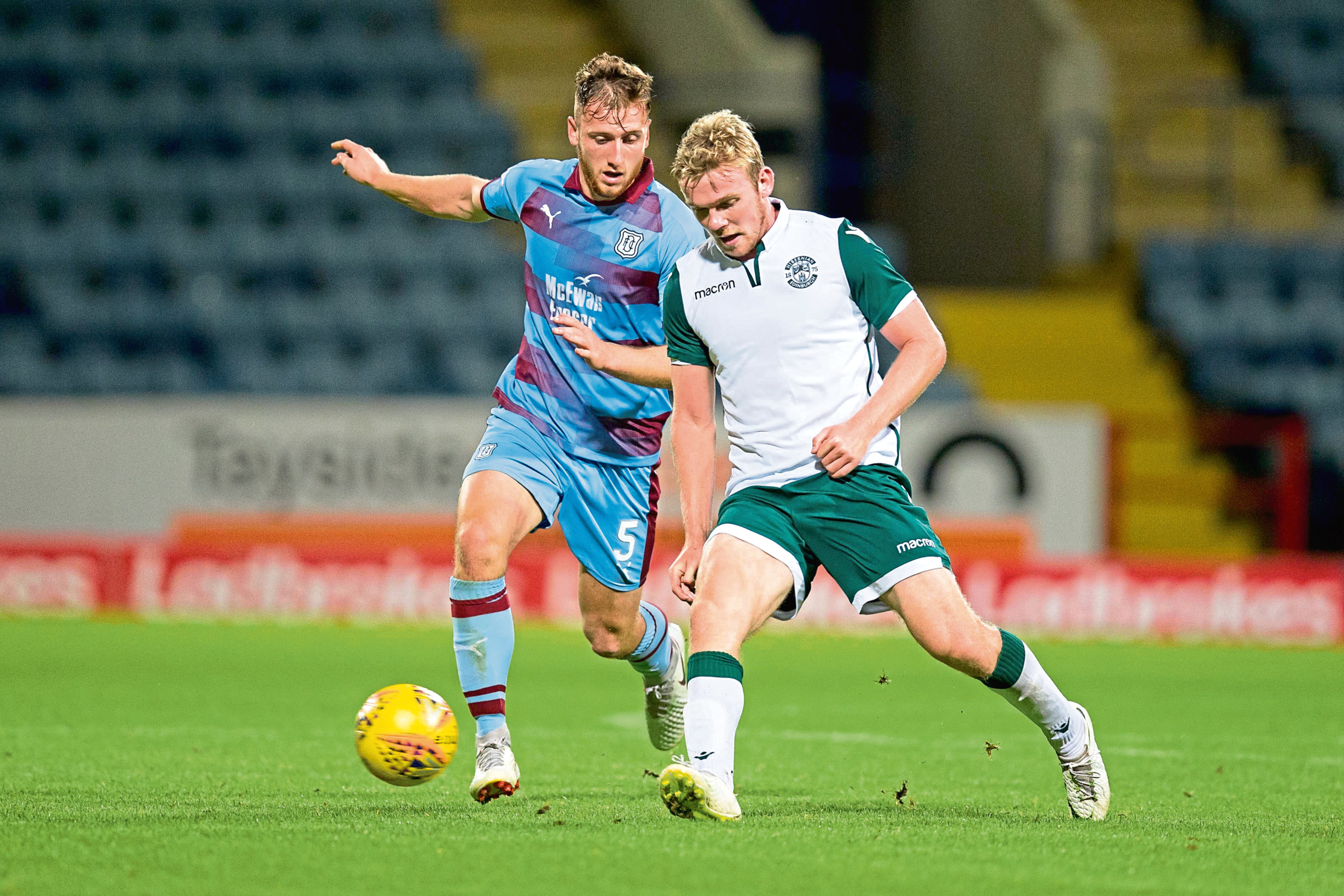 Dan Jefferies of Dundee challenges for the ball with Lewis Allan of Hibernian