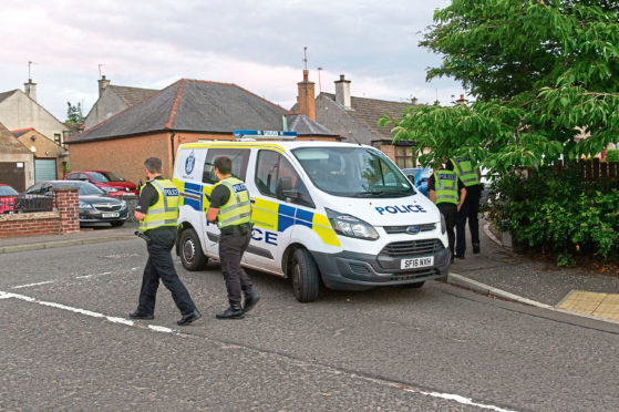 Police at the scene of the incident at Old Halkerton Road in Forfar